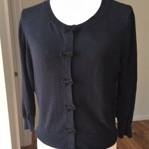Elle cotton blend sweater with bows and sheer back